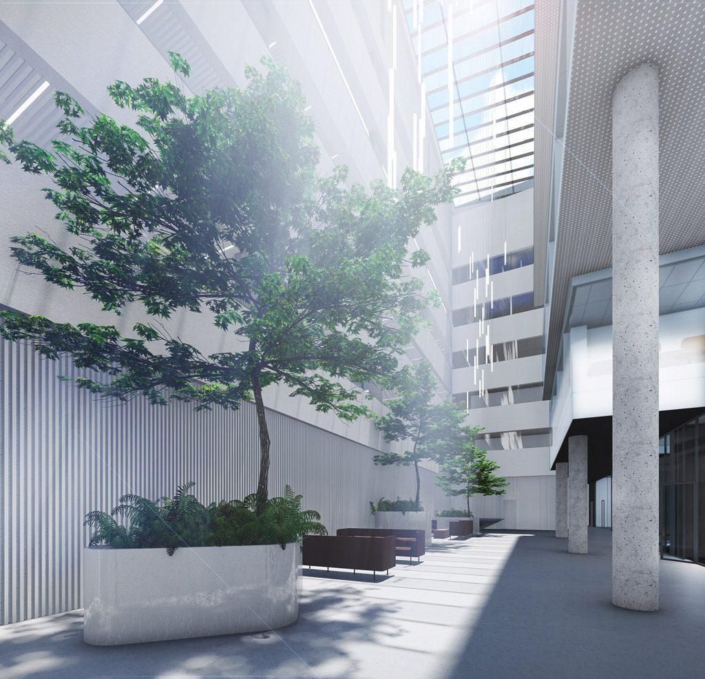 """Statomas """"Avia Solutions group"""" administracinis pastatas turi vertikalių fasado briaunų, kurios sudaro šešėlį ir vidinį atrijų, kur susikaupusi šiluma išleidžiama pro stikliniame stoge įrengtas atidaromas dalis. Vilniaus architektūros studijos vizual."""