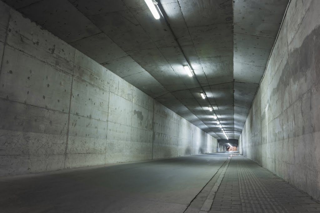 abandoned tunnel with damaged walls